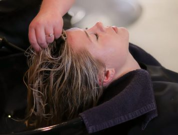woman moisturizing hair naturally